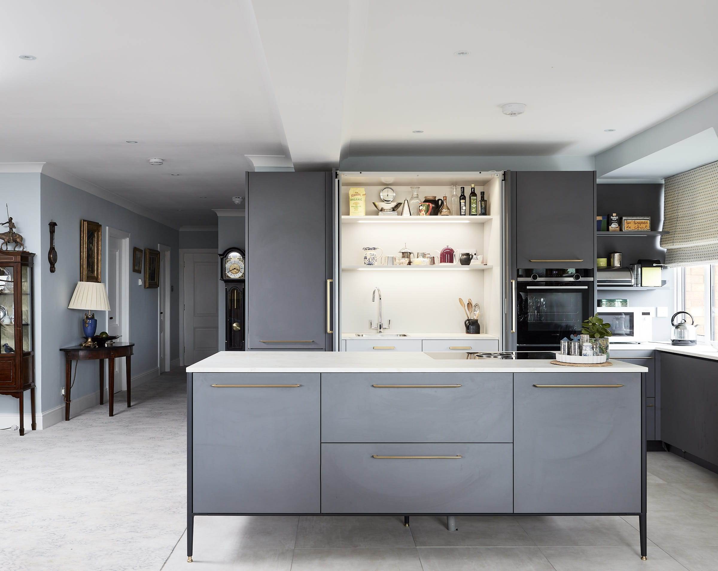 Interior design Dublin. The kitchen had to be installed in the centre of the living space to the kitchen was designed So that the entire working kitchen could be closed off when not in use.